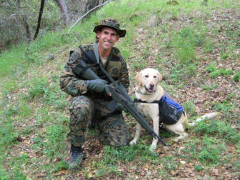 Lt. John Nores and dog. Photo courtesy California Fish & Wildlife.