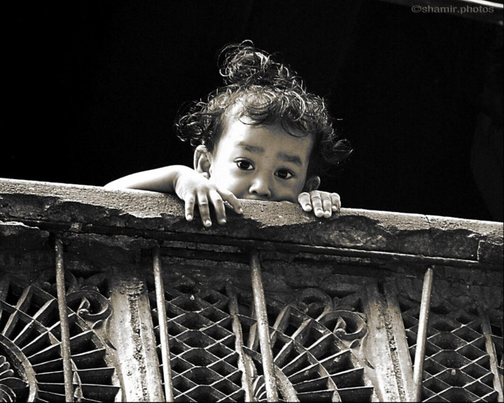 child on balcony